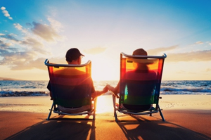retired couple, beach, sunset