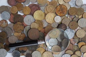 coins-magnifying-glass