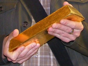 holding-gold-bar